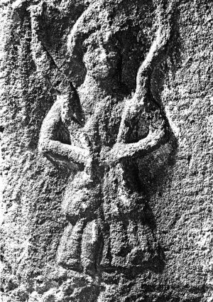 Christianity, especially in rural areas with a deep pagan tradition, can never entirely purge itself of the past. In the parish church of Ilkley, West Yorkshire, there is a stone carving which is usually identified as the Romano-British goddess Verbeia (above). In her hands she holds two writhing snakes, resembling the famous Minoan snake goddess statuette found in Knossos, Crete. Verbeia is said to be goddess of the River Wharfe, which flows through Ilkley, forming the familiar goddess-serpent-water associations. However, one historian of Ilkley believes the goddess is only superficially associated with the river itself, and was once associated with the brooks flowing down from springs on the famous neighbouring moorlands. On these moors are numerous prehistoric rock carvings, stone circles, and traces of human settlement dating back to 7000 BCE; Verbeia is probably a survival of more ancient myths in the area. The historian notes the double snake symbol's connection with healing (look at the British Medical Association's symbol), and the long-standing reputation of the moor's waters for healing properties, which survived into Victorian times, when a renowned healing spa was set up near the edge of the moor.